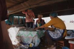 ladies making mutton pancakes