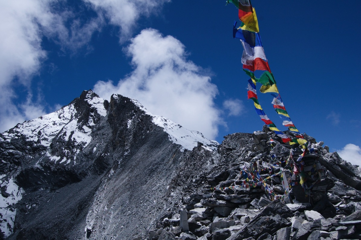 How to Trek the Three Passes Independently: mountains with prayer flags