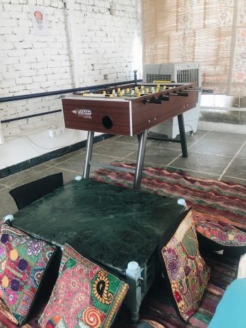 Best Sunset Spot in Udaipur: hostel common area with foosball table