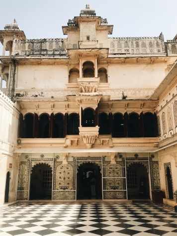 Best Sunset Spot in Udaipur: checkered palace floors and awning