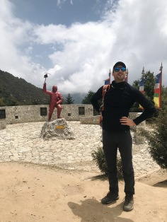 How to Trek the Three Passes Independently: man posing in front of tenzing norgay statue