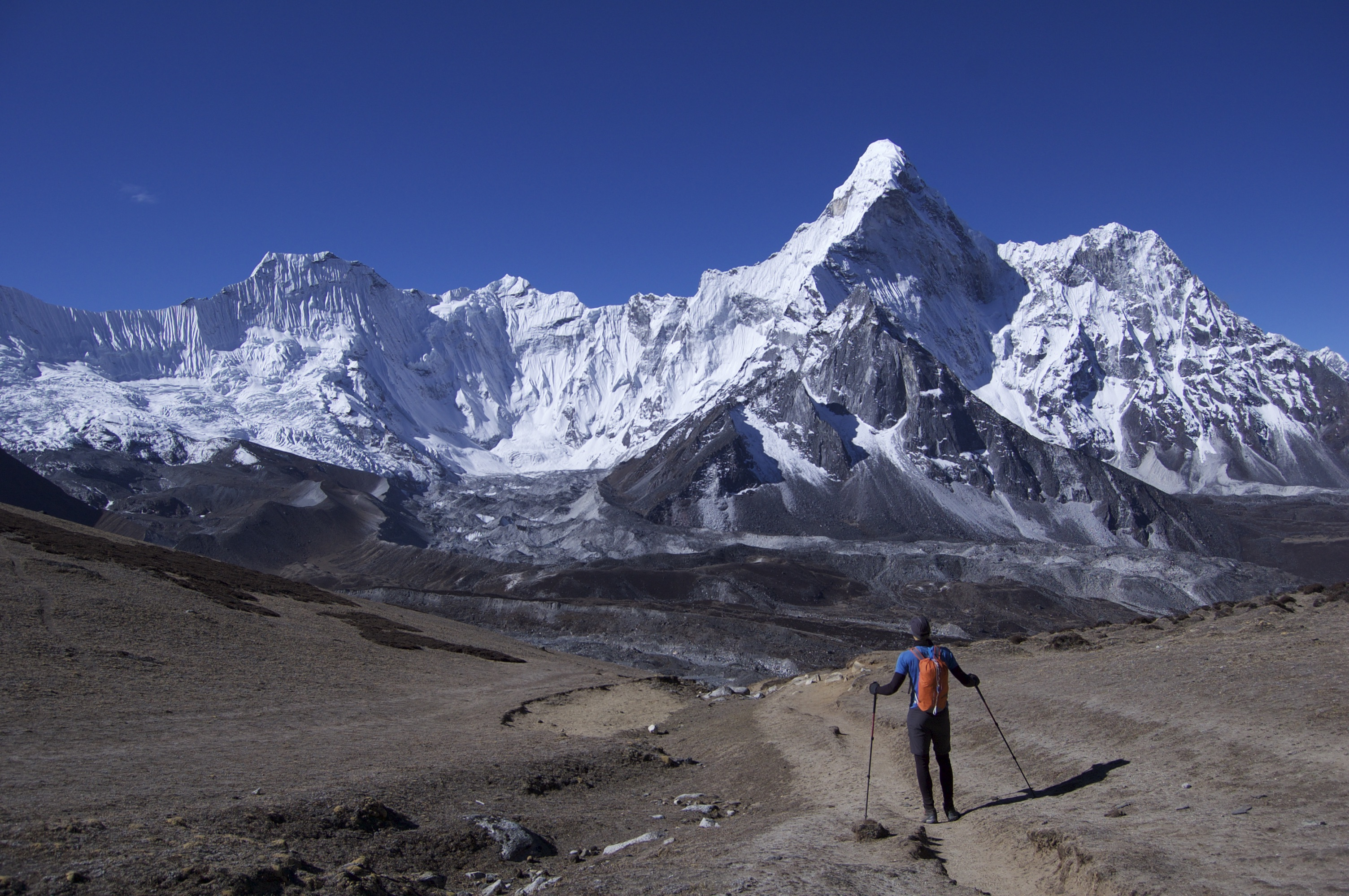 How to Trek the Three Passes Independently: man overlooking mountains